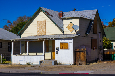 Old Boarded Up Home Lost To Foreclosure During Recession