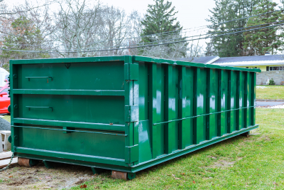 photo of a green dumpster rental